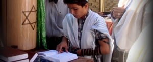 Boy reading Bar Mitzvah